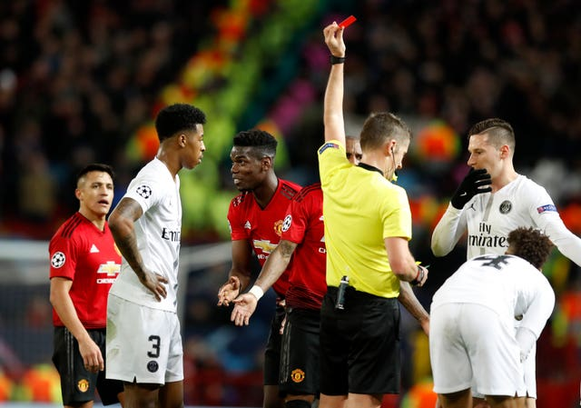 Paul Pogba, centre, was sent off in the first leg of the Champions League last 16 clash at Old Trafford (Martin Rickett/PA)