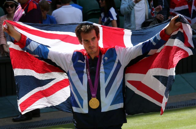Andy Murray with his gold medal after beating Roger Federer