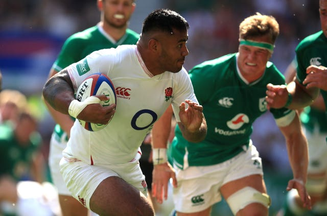 Manu Tuilagi, left, scores against Ireland