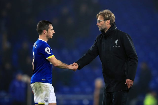 Liverpool manager Jurgen Klopp (right) shakes hands with Everton's Leighton Baines