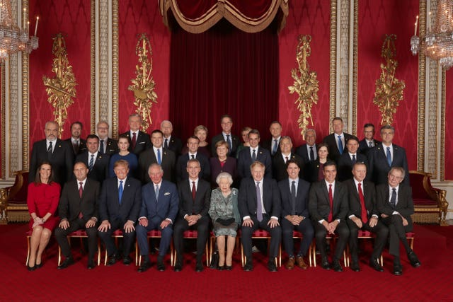 Leaders of Nato alliance countries and its secretary general join the Queen and the Prince of Wales for a group picture during a reception in Buckingham Palace