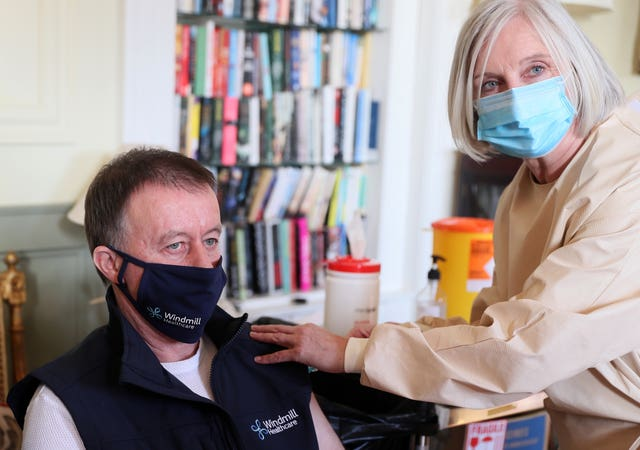 Declan Brazil, head of maintenance at the care centre, receives his vaccine