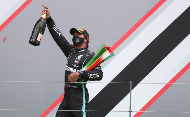 Hamilton on the podium after his record-breaking triumph in Portugal