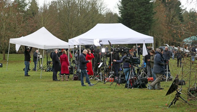 Members of the media gathered outside the visitors' centre at the Sandringham Estate, Norfolk, waiting for developments to be announced about the royal summit. Steve Parsons/PA Wire