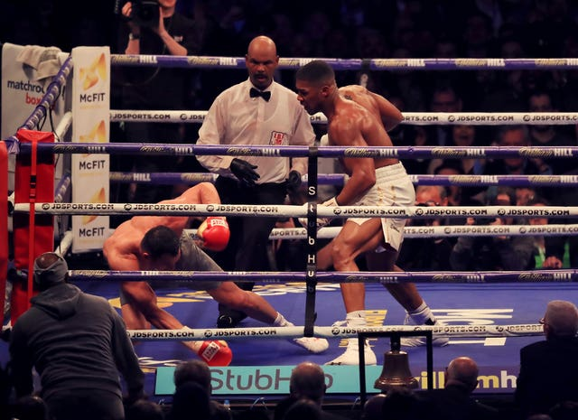 Anthony Joshua, right, knocks Wladimir Klitschko to the canvas