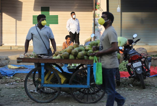 Indians shop for vegetables during lockdown in Bangalore