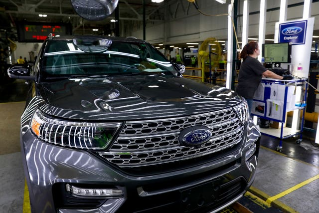 Ford employees on an assembly line