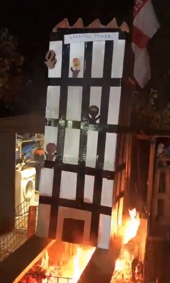 Grab taken from a video posted on social media of a model of Grenfell Tower being burned over a fire