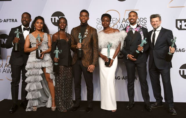 Sterling K Brown, from left, Angela Bassett, Lupita Nyong'o, Chadwick Boseman, Danai Gurira, Michael B Jordan, and Andy Serkis pose with the award for outstanding performance by a cast in a motion picture for Black Panther
