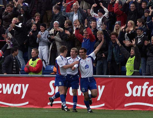 John Peterson (number 10) celebrates acoring the second goal for the Faroe Islands against Scotland in Toftir