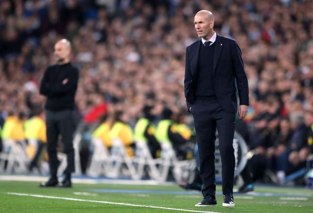 Pep Guardiola, left, go the better of Real Madrid manager Zinedine Zidane