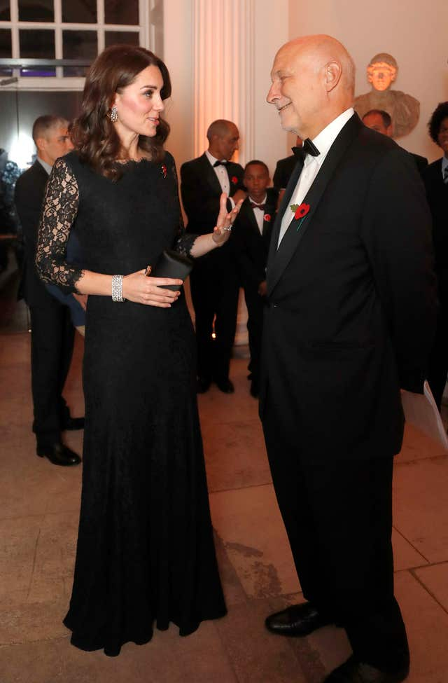 The Duchess of Cambridge speaks to Peter Fonagy, CEO of the Anna Freud National Centre for Children and Families during the gala dinner at Kensington Palace (Frank Augstein/PA)