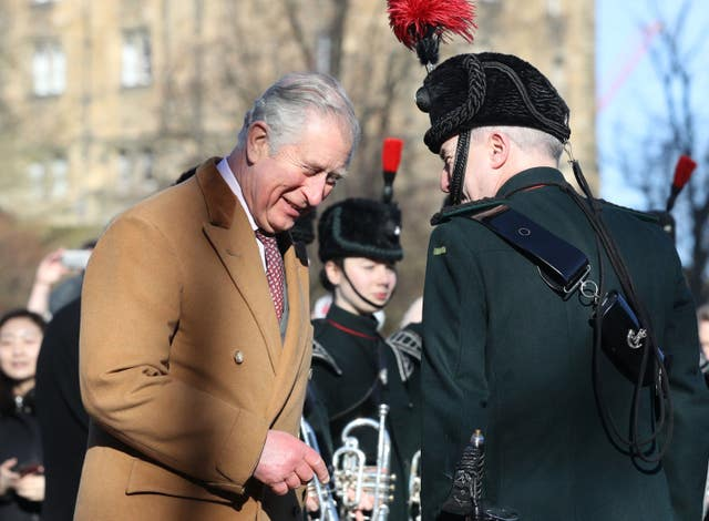 The Prince of Wales meets members of the Durham Light Infantry near to Durham Castle (Owen Humphreys/PA)