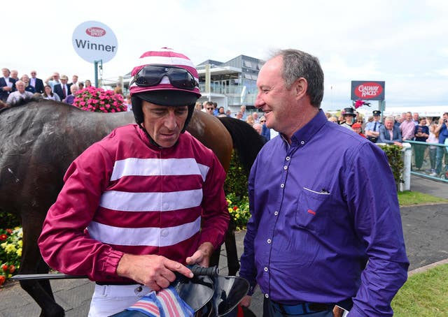 Davy Russell (left) will ride Folsom Blue for the first time in five years