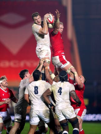 England's Joe Launchbury wins the line out ball ahead of Wales' Alun Wyn Jones during the Autumn Nations Cup match