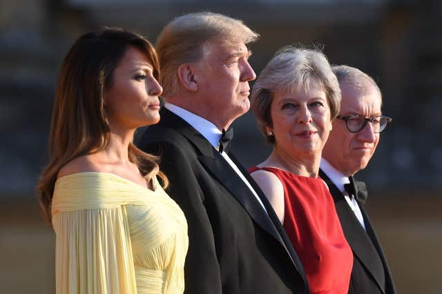 Donald Trump and his wife Melania are welcomed by Theresa May and her husband Philip at Blenheim Palace