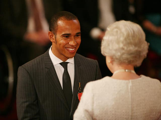 Hamilton was awarded an MBE by the Queen after he won his first title