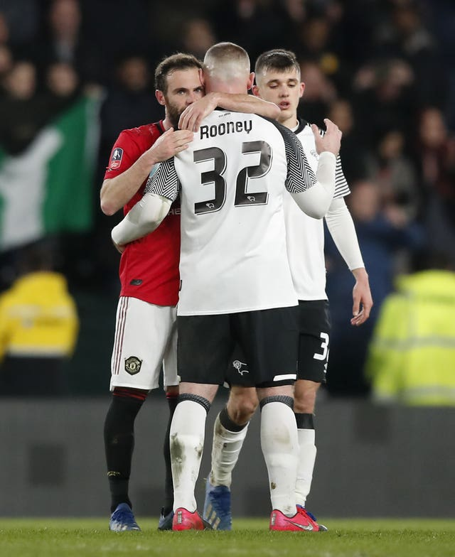 Juan Mata consoled Wayne Rooney after Manchester United won at Derby