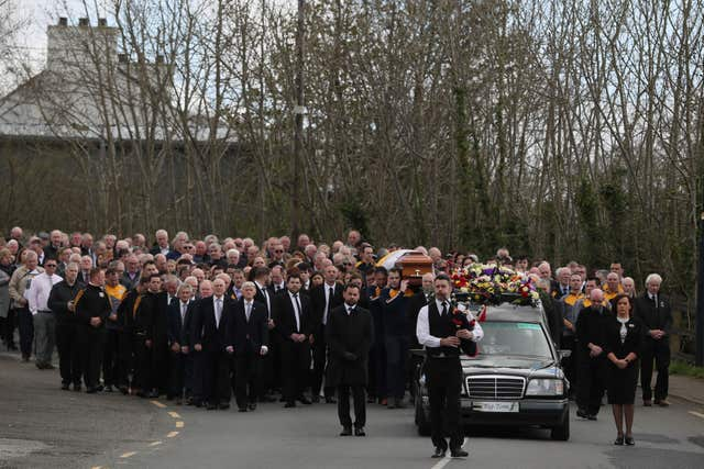 The funeral cortege makes it way to Saint Patrick's Church (Brian Lawless/PA)