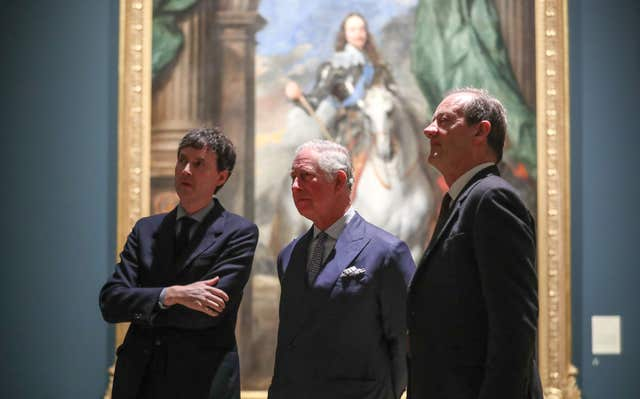 The Prince of Wales with curators Desmond Shawe-Taylor, right, and Per Rumberg (Andrew Matthews/PA)