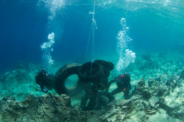 Volunteer divers collect tires from the sea floor in Saronic gulf near Athens (Vassilis Tsiairis/Aegean Rebreath via AP)