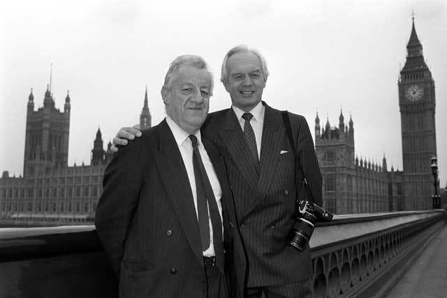 Moncrieff was awarded a CBE in the 1990 New Year Honours - he's pictured alongside PA royal photographer Ron Bell who became an MVO (Member of the Royal Victorian Order)