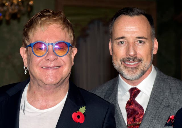 Sir Elton John and David Furnish at Winfield House in London (Hannah McKay/PA)