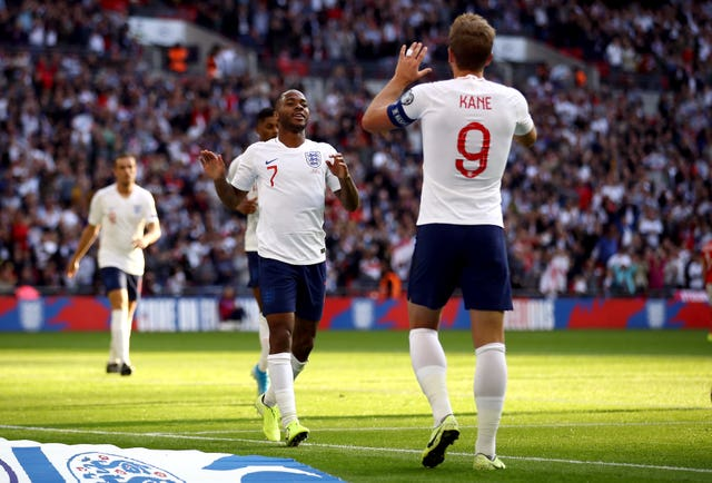 Raheem Sterling is congratulated on his goal by Harry Kane