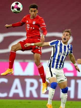 Bayern Munich's Jamal Musiala, left, has earned the trust of head coach Hansi Flick and played four times this season