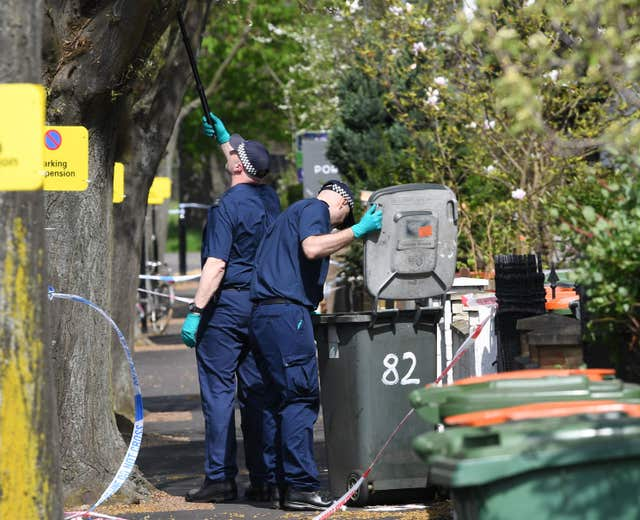Officers search bins in Chestnut Avenue in Forest Gate after Sami Sidhom's death (Stefan Rousseau/PA)