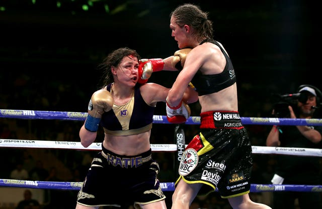 Delfine Persoon, right, lands a punch against Katie Taylor