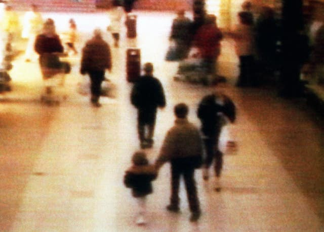 CCTV showing James Bulger being led away in the New Strand shopping centre in the Bootle area of Liverpool in 1993 (PA)