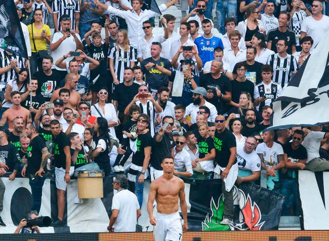 Cristiano Ronaldo celebrates in front of the Juventus fans (Andrea Di Marco/ANSA via AP).