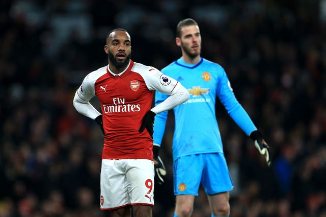 Arsenal's Alexandre Lacazette (left) and Manchester United goalkeeper David De Gea