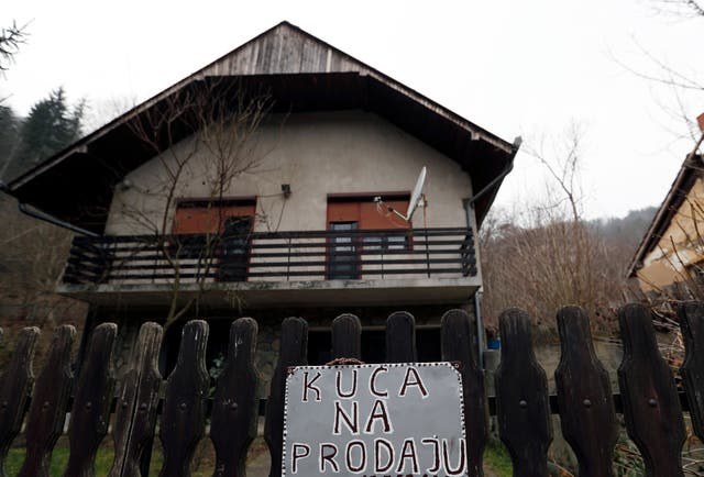 A sign reading in Serbian 'House for sale' in the village of Blagojev Kamen, Serbia