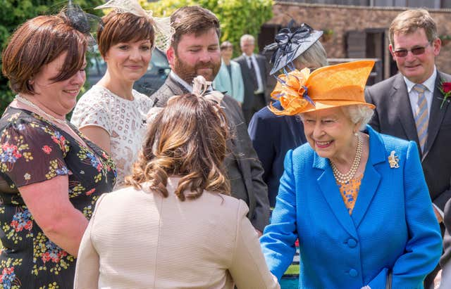 The Queen meets Duchy of Lancaster estate staff and tenants during a visit to Lower Castle Hayes farm, in Draycott-in-the-Clay, Ashbourne, Staffordshire. Richard Stonehouse/PA Wire