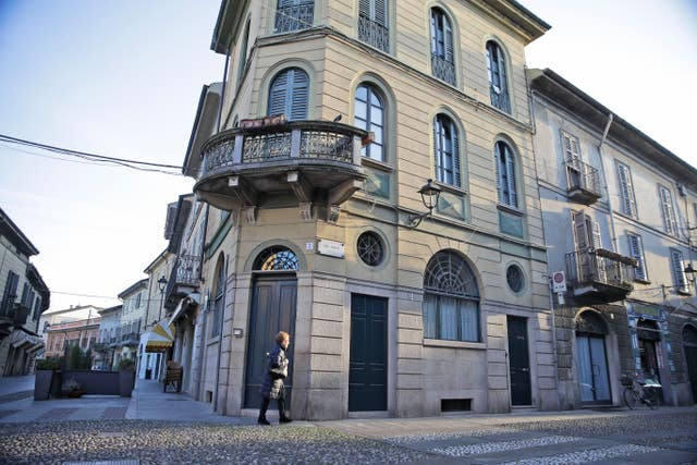 A woman walks in a street in the centre of Codogno, near Lodi in northern Italy