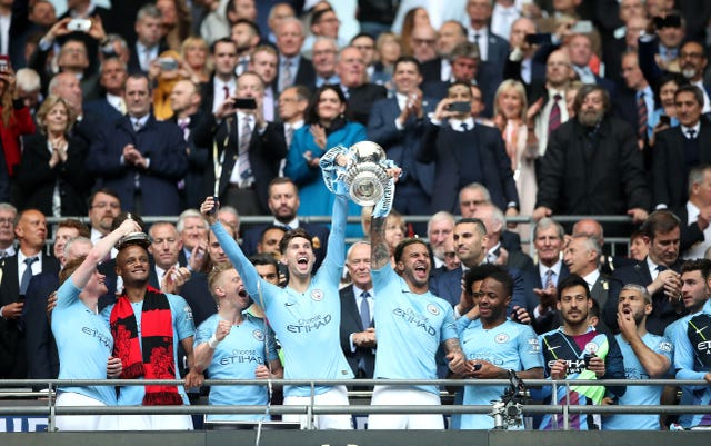 Manchester City's players celebrate the FA Cup triumph