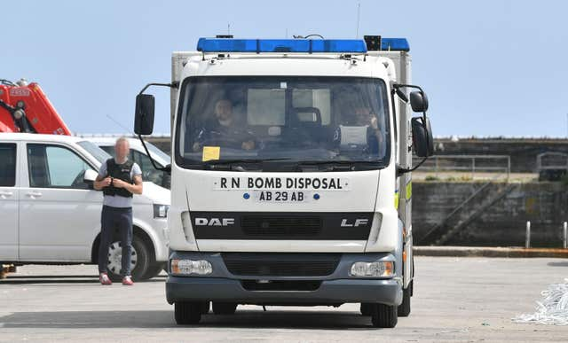 Bomb disposal units and National Crime Agency officers at Newlyn harbour after yacht was seized in the English Channel (Ben Birchall/PA)