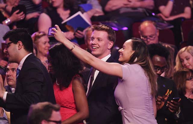 Audience members take selfies before the concert began (Andrew Parsons/Sunday Times/PA)