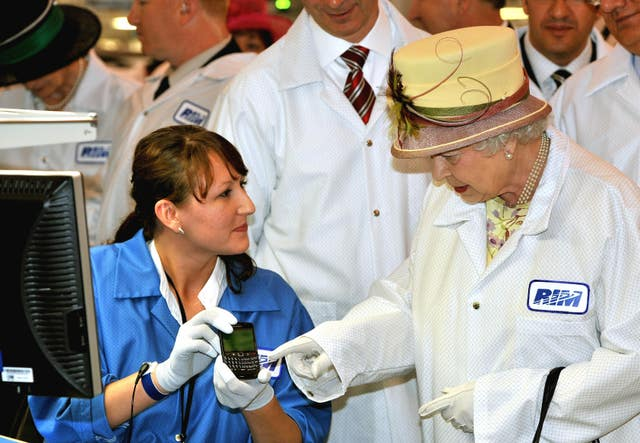 The Queen looking at a Blackberry