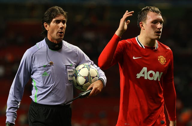 Phil Jones (right) scored a late goal, but it was not enough for United to progress