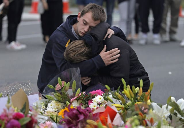 Mourners pay their respects at a makeshift memorial near the Masjid Al Noor mosque in Christchurch