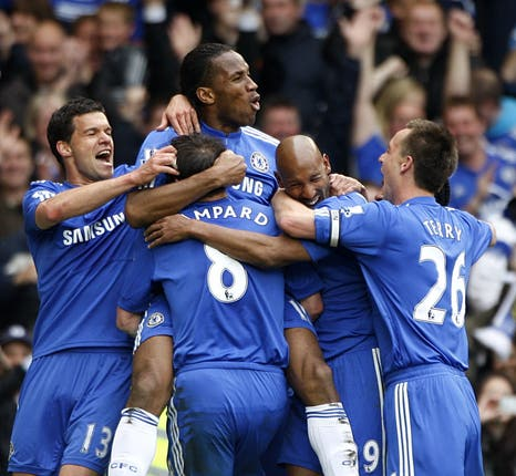 Didier Drogba, second left, scored a hat-trick as Chelsea clinched the title in style against Wigan