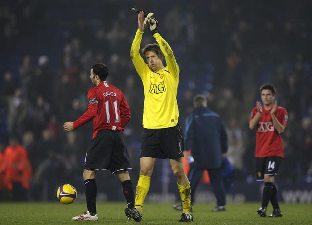 Manchester United's goalkeeper Edwin Van der Sar celebrates after the final whistle