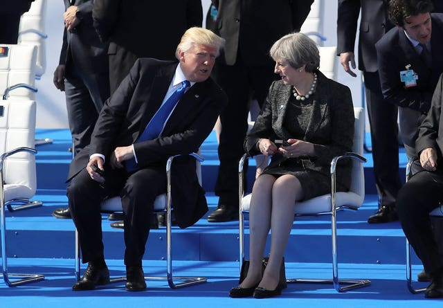 Donald Trump with Theresa May at the Nato summit in Brussels