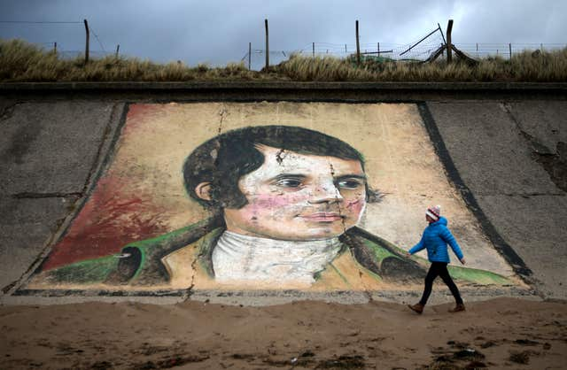 A mural of Robert Burns on the sea wall at Ardeer beach, near to his birthplace of Alloway in Ayrshire (Jane Barlow/PA)