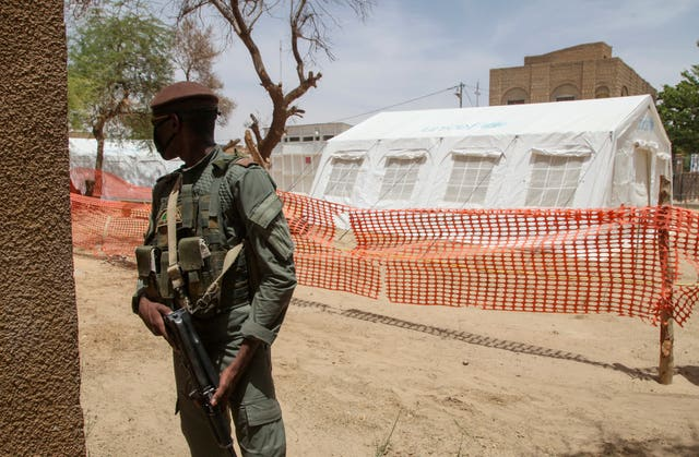 A Malian soldier stands near the isolation tent for patients with coronavirus in Timbuktu (Baba Ahmed/AP)