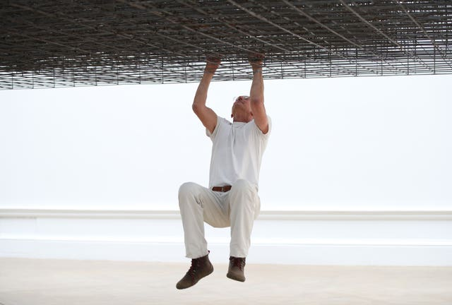 Antony Gormley poses with his installation Matrix III (2019)