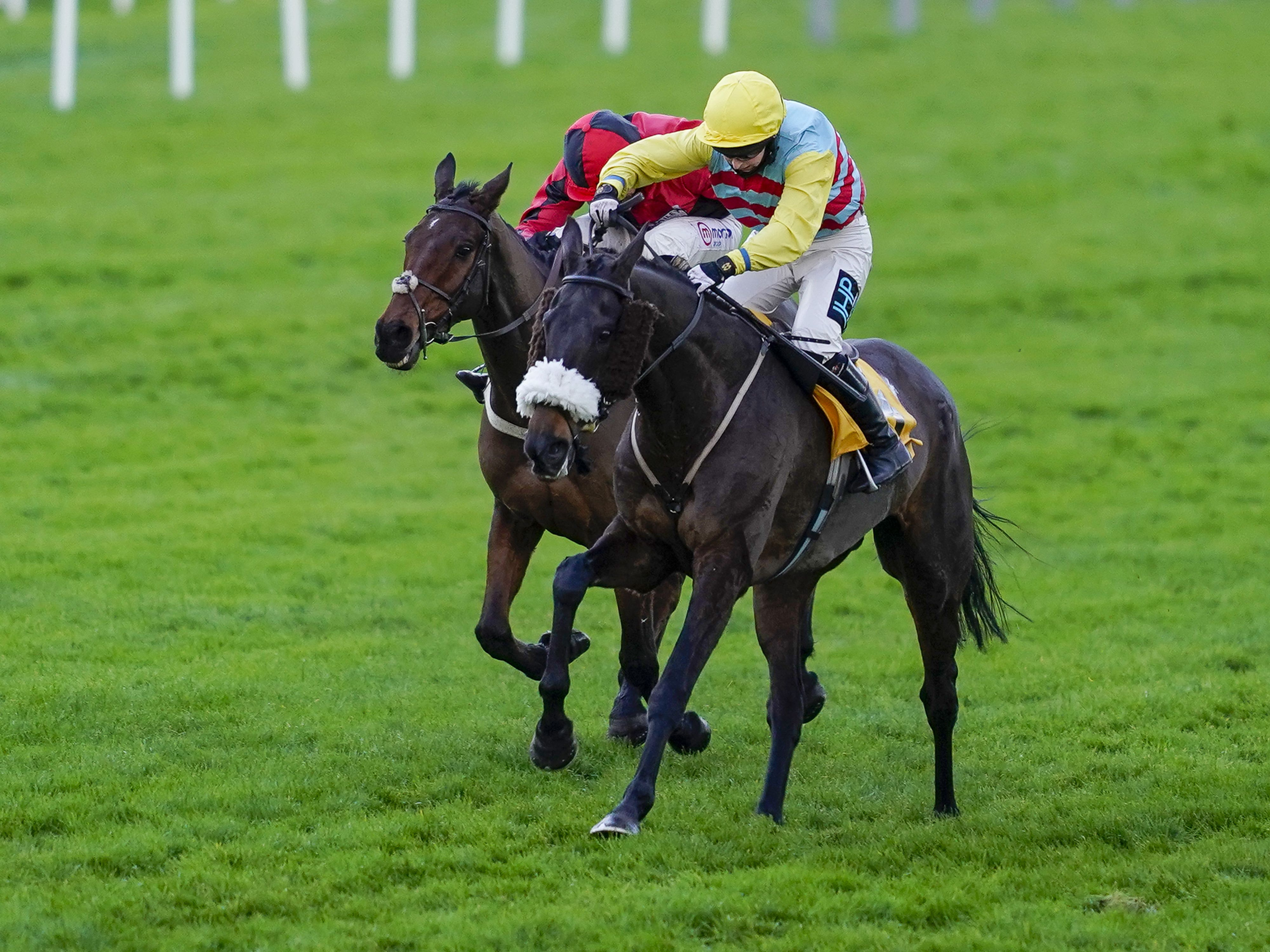 Millie Wonnacott and Doing Fine (right) hold the challenge of Crosspark to win The Betfair Exchange Back And Lay London National Handicap Chase at Sandown (Alan Crowhurst/PA)